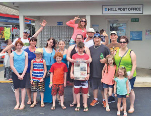 The gang posed for a picture with The Post at the Hell Post Office on Grand Cayman.