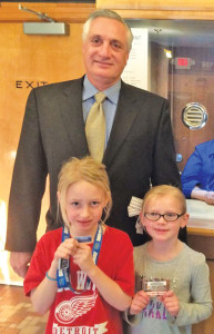 Mike Metzger, who started the first library card roundup in 1997, was on hand to help celebrate this year's event at the Kent Theatre. Here he poses with two Cedar Trails students.