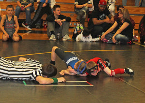 Brandson Wood pins his opponent. Photo by J. Troupe.