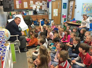 State Representative Rob VerHeulen read to Kindergarten and First grade students during National Reading Month.