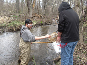 CTA students teamed up in several groups to monitor bugs in Cedar Creek. Photo by J. Reed.