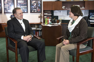 Kathy Maguire talks with Michigan State University basketball coach, Tom Izzo, after accepting her Excellence in Education award.
