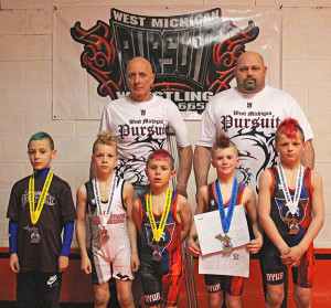 West Michigan Pursuit wrestlers that placed at the state tournament. Pictured from left to right:  Back Row, Coach Bill Ketchum and Dave Andrus. Front Row: Josh Vasquez, Luke Egan, Chayson Eberspeaker, Drew Moro and Blake Peasley. Missing are Zak Schmid, Logan Hull, Lucus Pienton and Jordan Andrus. Photo by B. Chong.