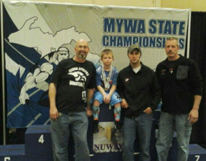 Pictured left to right is Coach Bryan Goike, Jonathan Libera-7th place, Coach Jake Marsman and Coach Scott Marsman.