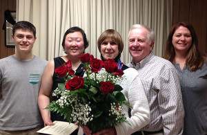 Pictured in the photo (from left to right): Grandson Alec Falicki, daughter Soonja Koole, Woman of the Year Carolyn Davis, husband Dan Davis, daughter Kelli Koole Clark.