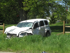This PT Cruiser was heading west on 17 Mile when it was hit by a northbound van at Sparta Ave. Post photo by J. Reed.