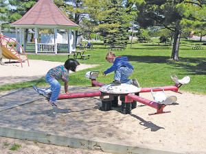 Playing at an area park is just one of the ways for kids and parents to beat the boredom of long summer days until school starts again.