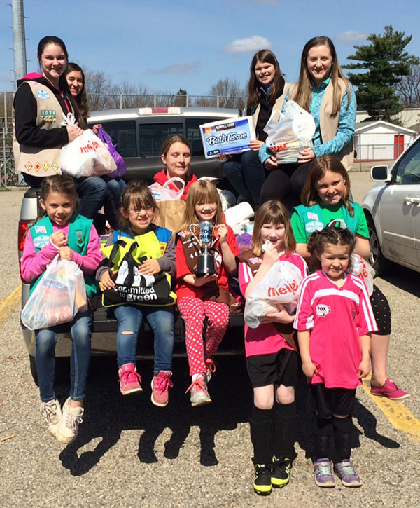 Area Girl Scouts held a food scavenger hunt and donated it all to the local Cedar Springs food pantry. Courtesy photo.