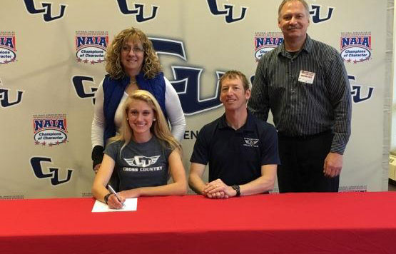 Ellie Ovokaitys recently signed a letter of intent to run for Cornerstone University. She is shown here with her parents.