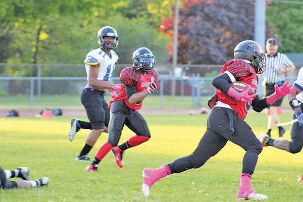 The West Michigan Hawks played for breast cancer awareness last Saturday. Photo by Marcie Crouch.