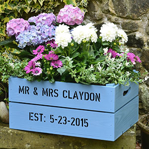 Crates, recycled or purchased, can be painted and personalized to create a colorful, unique planter for flowers and edibles.