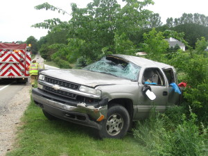 This pickup truck rolled Friday morning, June 10, injuring the female driver and two young passengers. Post photo by J. Reed.
