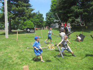 Kids had a blast playfighting with toy swords and other middle age weaponry. Post photo by J. Reed.