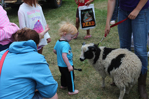 Animals from Double K Farm are always a hit at the kickoff of the Summer Reading program at the Cedar Springs Library. Courtesy photo. Kids really enjoy the ice cream at the kickoff of the Summer Reading program. Courtesy photo.