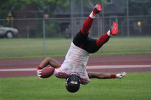 WM Hawk Ryan Bell did a flip when he crossed the goal line to celebrate a touchdown. Photo by M. Crouch.