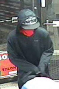 This is a surveillance photo of one of the armed robbery suspects at the Circle K gas station on West River Drive.