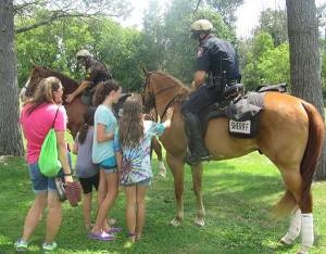 The Kent County Sheriff Department's Mounted Unit was a big hit with kids of all ages at the summer reading celebration. Photo by J. Reed.