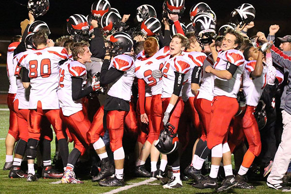 This was the scene last fall after the Cedar Springs Red Hawks beat Northview and were champions for the second year in a row in the OK Bronze. They kick off their season tonight (Thursday, August 25) at Zeeland West. Photo by K. Alvesteffer and Rob Lalone.