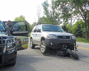 This SUV rear-ended a motorcycle Monday, in Solon Township. Post photo by J. Reed.