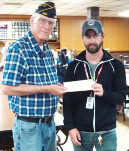 Shown presenting a check in the amount of $200.00 to the Vet's Home is Post Commander Bill Yuncker.