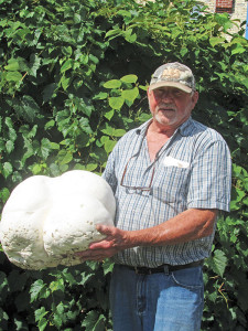 Barry Arthur with the giant puffball mushroom he found in Spencer Township. Post photo by J. Reed.