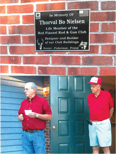 "TOP: This plaque was dedicated in memory of Thorval ""Bo"" Nielsen at the Red Flannel Rod and Gun Club. BOTTOM: Don Boezwinkle (left) and Bob Townes (right) at the dedication ceremony for Bo Nielsen."