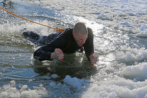 During ice safety training, recruits jumped into an ice hole and learned to use their issued ice picks to maneuver out of the hole. All safety precautions were taken during the exercise to ensure recruit safety
