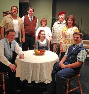 Cast names (in photo) are:  seated: RJ Moore, Anna Ambrose, Tom Johnson. Standing l-r: Rod Zamarron, Mark Stoll, Deb Irwin, Doug Christensen, Laura Johnson.