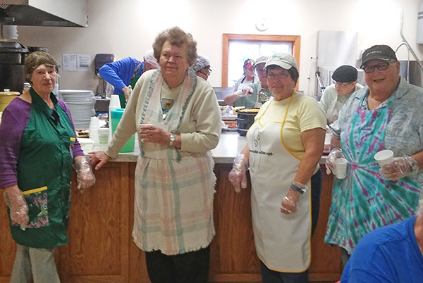 Members of the Women's Club and Rotarians helping out with a meal at St. John Paul II Catholic Church. Courtesy photo.