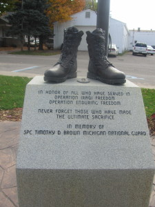 The way the Timothy Brown statue looked after someone stole the replica rifle, hat and dog tags. Post photo by J. Reed.