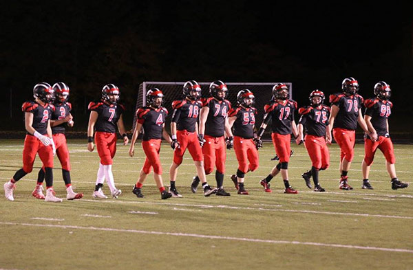 The Cedar Springs Varsity Football seniors walk across Red Hawk field one last time after their win over Ottawa Hills last Friday. Photo by K. Alvesteffer/R. LaLone.