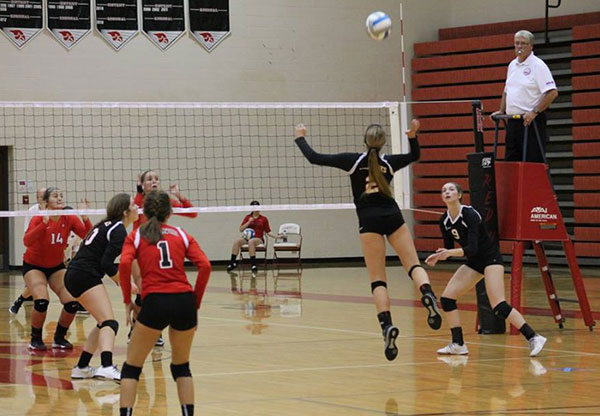 Outside hitter Sydney Plummer (#2) goes up for a kill while Brooke Morris #9, Sienna Wight #10 and Kaitlyn Coons #2 cover.