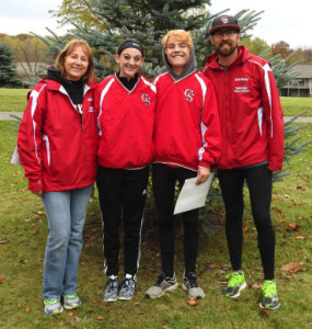Red Hawk runners Hannah Heintzleman and Dallas Mora will head to the Cross Country state finals this weekend. Pictured (L to R) is: Girls Varsity Coach Marie Covey, Hannah Heintzleman, Dallas Mora, and Boys Varsity Coach Garrett Lacey.
