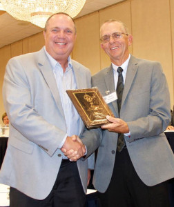 Dave Schlump (left), of Cedar Springs, receiving the 2016 BCAM Men's Junior College Coach of the Year award.