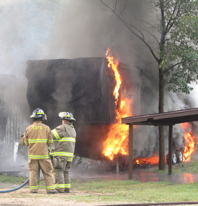 The fire spread from the pole barn to an adjacent RV. Photo by J. Reed.