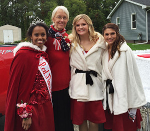 Red Flannel Queen Mumina Ciise (left) is shown here on Red Flannel Day with Grand Marshal and Library Director Donna Clark, and court members Kaley Louck and Madison Case. Photo courtesy of the Red Flannel Festival.