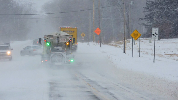 An example of a road commission truck with green lights while plowing snow. Photo courtesy of Kent County Road Commission.