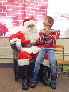 Above: Ethan Gerhardt, 7, tells Santa what he wants for Christmas. Post photo by J. Reed.