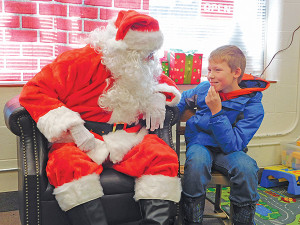 Right: Zach Gerhardt, 10, thinks about what he wants from Santa. Photo by J. Reed.