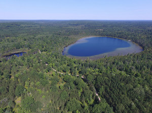 An aerial view of the Elk Forest at Black River project shows Walled Lake and a smaller pond located on the forested property. An application for grant funding was submitted in November for this project. The land is currently in private ownership. Michigan Department of Natural Resources