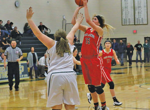 Sophomore Baylie Vandyke knocks down a short jumper over a Comstock Park defender Friday night.