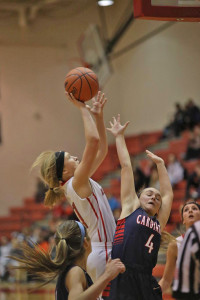 Senior Ali Sparling drives to the basket in the Friday, Dec. 2 game against Big Rapids.  Photo by K. Alvesteffer/R. LaLone