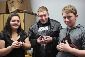 Biochemistry students Sierra Medwayosh, John Foss and Caleb Cook show the three chickens that were hatched during their hands-on mitosis and meiosis project.