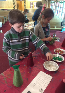 Elementary students work to craft gifts during the PA Santa's Workshop.