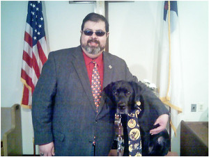 Pastor Darryl Miller with his leader dog, Rowdy.