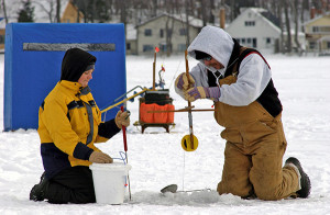 A couple of anglers enjoy their day ice fishing. Michigan Department of Natural Resources