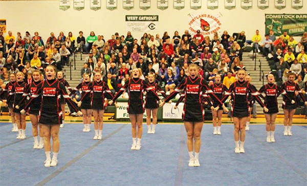 The Cedar Springs Varsity Competitive Cheer team at West Catholic High School.