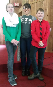 CTA Spelling Bee: Brenna Jibson, Middle School English Teacher Jenny Bangma and Conner Warner.