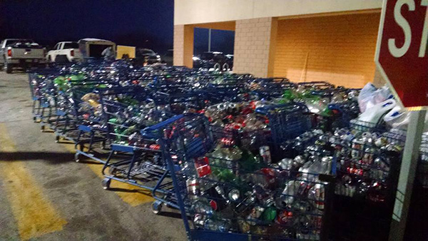 Carts full of cans were lined up inside and outside the Cedar Springs Meijer store Monday and Tuesday, as volunteers worked to feed over 86,000 of them into the machines. Photo courtesy of Team Rickerstrong.