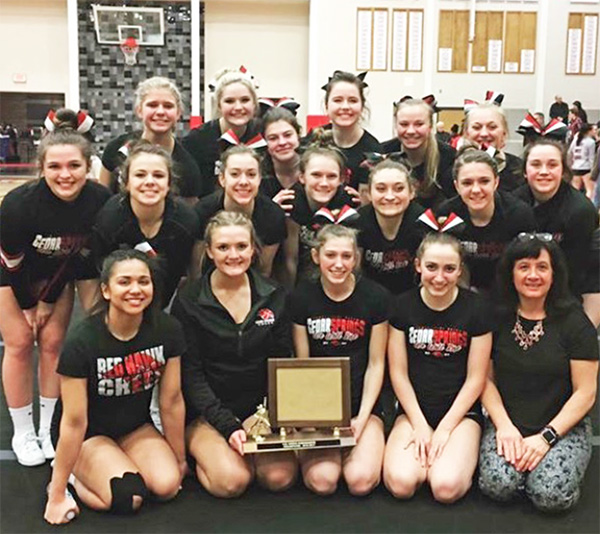The Varsity Cheer team after winning the OK White conference title last week.